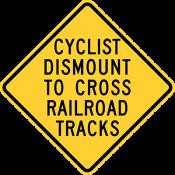 Cyclists Dismount To Cross Railroad Tracks