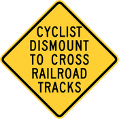 Cyclists Dismount To Cross Railroad Tracks