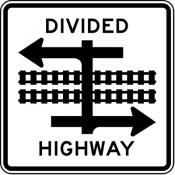 Divided highway transit rail crossing