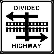 Divided highway transit rail crossing