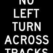 No left turn across tracks