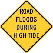 Road floods during high tide